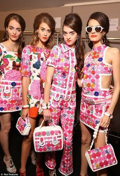 The flower power era characterized by hippie style ,natural cotton fabrics large collars mini length frocks and the hair worn in two pony tails.In this Moschino Milan 2014 fashion show we can see the flower power inspired bright colors knee length cotton fabric however the large collar is missing and the iconic two pony tails