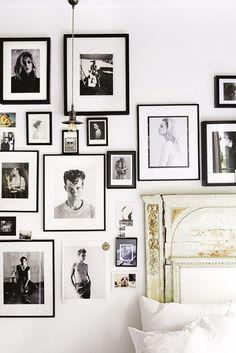 black and white photo wall and ornate headboard. / sfgirlbybay