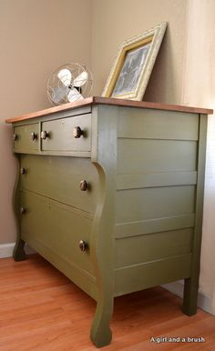green dresser with stained top.