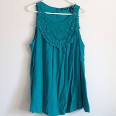 """Teal Lace Top Gorgeous top! Lace on chest area. Lightweight. On the back - one button closure. 100% rayon. Measurement laying flat: bust: 22.5"""" length: 26.5"""" No stains or holes. Millenium Tops"""