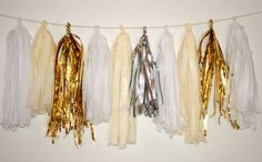 i'm afraid i'm going to need, like, seven. Gold, Cream, White, Silver Party Tassels (Set of 10). $15.00, via Etsy.