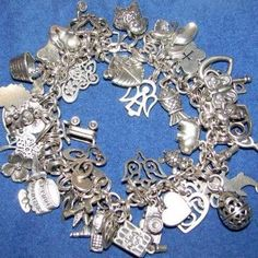 James Avery charm bracelet - still loving mine after all these years!...I need to convert mine to a necklace because it looks kind of like this ! ! !   CB