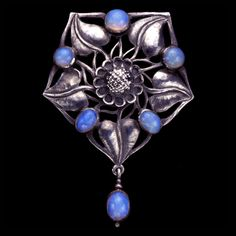 This is not contemporary - image from a gallery of vintage and/or antique objects. C. R. ASHBEE (1863-1942) THE GUILD OF HANDICRAFT Ltd. (1888-1907)  An Arts & Crafts, silver brooch set with an opals.