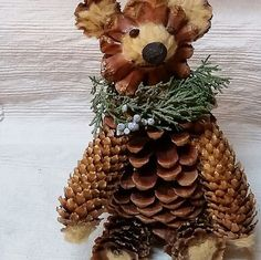 My uniquely designed pine cone bear made from sustainable materials I collected on Big Bear Lake hikes, including Jeffry pine cones under trees, juniper greenery and berries and acorns. The down on this lovable Teddy comes from sycamore seed pods in the High Desert. This bear complements woodland decor, as well as rustic, country and log house decor. Learn more, and if you desire, purchase this pine cone bear at my Oak Glen Creations Etsy Shop.