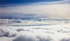 Blue sky and clouds - view from plane window by rawf8. Beautiful view of clouds and sky from a plane window