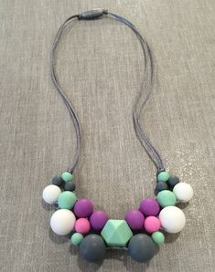 A personal favorite from my Etsy shop https://www.etsy.com/ca/listing/386154114/poppy-cluster-silicone-teething-necklace