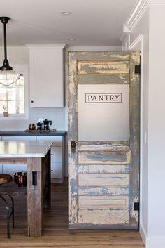Custom Rafterhouse pantry door. This door was an old antique door that we rebuilt and re-purposed as a pantry door.