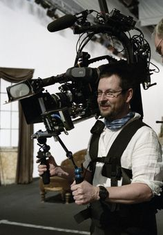 "Lars von Trier on the set of Dogville [2003]. . ."" is a Danish film director and screenwriter. He is closely associated with the Dogme 95 collective – an avant-garde filmmaking movement – although his own films have taken a variety of approaches. His work has frequently divided critical opinion."""