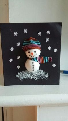 Christmas card I made with class. Used polystyrene ball cut in half and materials x