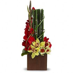 A modern arrangement with Yellow orchids, Red Gladioli delivered with a bamboo-like equisetum. Home Flowers, Flowers For You, Unique Flowers, Exotic Flowers, Fresh Flowers, Purple Flowers, Beautiful Flowers, Send Flowers, House Beautiful