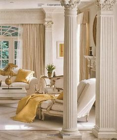Columns, creamy paint color and neutral palette combine to make this a gorgeous space.