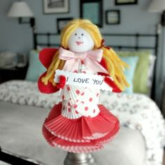 Toilet paper roll and cupcake liners make this cute little doll ..