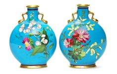 A pair of pilgrim flasks, attributed to Christopher Dresser, for Minton Circa 1872 With twin-handles, painted to each side with roses, crocuses and other flowers, on a bleu-céleste ground with gilding to rim, handles and foot;