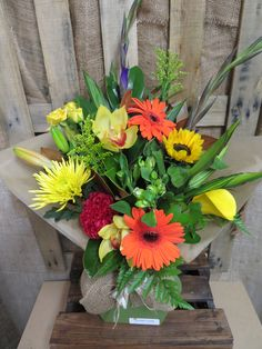 Lovely bright mix of flowers created by Florist ilene. Beautifully arranged into a waterfilled box