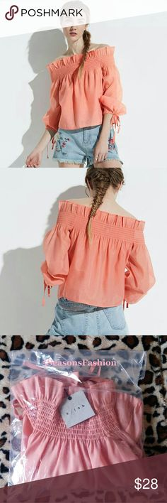 Smocked Off The Shoulder Top BELL SLEEVE Tied Cuff BRAND NEW WITH TAGS!!! Trendy FESTIVAL READY top. 100% polyester fabric with a slight sheen to it. Machine wash. Long bell sleeves with adjustable tied cuffs. Elastic off the shoulder neckline. Size XS. Fits like sm/xs. Color PEACH. Beautifully well made design.  Bundle with other items in my closet for a personalized bundle discount. klab Tops Blouses