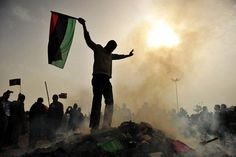 """Protester stands on top of the burning of """"Green Books"""""""