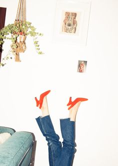 Inside Accessories Designer Amélie Pichard's Closet: Pointy Toe Red High Heels with a Back Strap, Oversized Denim Jeans | coveteur.com