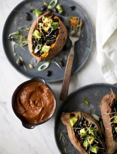 Big Comfy Sweet Potatoes with Red Blanket Sauce by mynewroots: More than fine without the sauce but with the sauce that tastes like a thousand layers of spice, herbs, sweet, savory, tangy, bold....! #Sweet_Potato #Black_Beans #Avocado