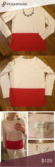 """Kate Spade colorblock sweater Worn literally once! Like new! The only """"flaw"""" is a little pen mark on the inside tag--obviously not an issue! Love the color combo! Blush pink on top and reddish-pinkish-orange on the bottom. Merino wool. Slits on the sides and the cutest little bow at the top of the back. kate spade Sweaters Crew & Scoop Necks"""