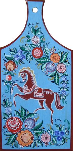 Wooden chopping board decorated with traditional Gorodets painting from Russia. #folk #art