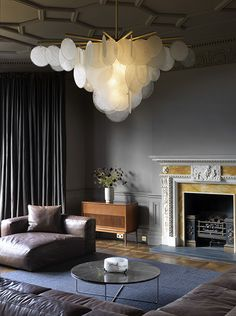 what i like is the mix of contempt lightg with classical fireplace. CTO UK lighting