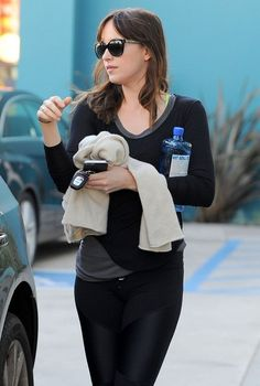 Dakota Johnson Photos Photos - Actress Dakota Johnson hits up a yoga class in West Hollwyood, California to buy some healthy groceries on January 17, 2014. Dakota will soon be seen in the highly anticipated film, '50 Shades Of Grey' which hits theaters on February 13! - Dakota Johnson Hits Up A Yoga Class