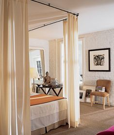 Designer Antony Todd. Instead of a bulky four-poster bed, hang the curtains from the ceiling.