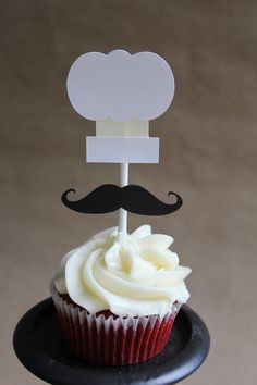 Set of 12 chef hat and mustache cupcake toppers. Set includes 12 chef hat and mustaches as pictured. Made with black, heavy cardstock paper.