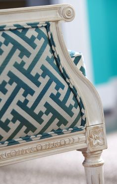 Mix and mismatch. Upholster a classic French chair in a modern fretwork fabric.