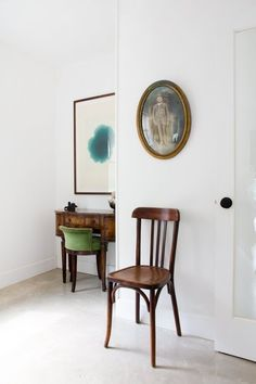 8 Sneaky Ways to Create the Illusion of More Space:  a nice way of having traditional furniture not look so heavy or old. The white really looks good.