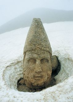 Nemrut Mountain, Turkey, notable for the summit where a number of large statues are erected around what is assumed to be a royal tomb from the 1st century BC.