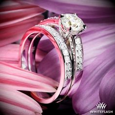 """A genuinely exceptional pair, the """"Flush-Fit"""" Diamond Wedding Set makes a lasting impact. The """"Flush-Fit"""" Diamond Engagement Ring sparkles with 12 A CUT ABOVE® Hearts and Arrows Diamond Melee (0.27ctw; F/G VS) 2 of which are nestled in the gallery of the head, while the """"Flush-Fit"""" Diamond Wedding Ring shines with 11 A CUT ABOVE® Hearts and Arrows Diamond Melee (0.15ctw; F/G VS)."""