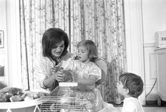 ST-A28-9-62. First Lady Jacqueline Kennedy, Caroline Kennedy, and John F. Kennedy, Jr., with Birds - John F. Kennedy Presidential Library & Museum