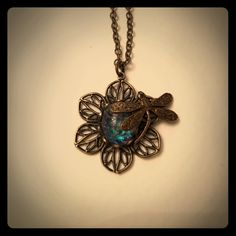 Handmade dragonfly necklace Beautiful blue! Handmade dragonfly necklace with a heliotrope cabochon that ranges from a deep blue to a green but is mostly blue. Reminds me of dragonfly wings also! Comes on an 18 and a half inch chain. Perfect for antique lovers! Jewelry Necklaces