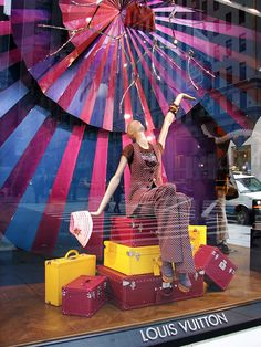 Louis Vuitton window display has a contrast made between the yellow and radiant orchid colour on the carrier bags. Yellow and radiant orchid are complementary colours, thus they help each other to  distinguish their own engaging colour. Also, background prop, which comes along with the various tones of radiant orchid colour, makes burgundy colour bag attractive look.