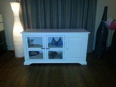 Van een oude dressoir hebben we een konijnenhok van gemaakt Door Anneke83