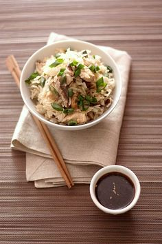 Steam cooked thai rice with marinated chicken in teriyaki sauce, scallions and shiitake