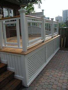 A formal deck plan originally built in Toronto and featured in Canadian House and Home. Unique privacy screens set this deck design apart! House With Porch, Building A Deck, Deck Skirting, Patio Design, Pergola Plans, Diy Deck, Canadian House, Deck Design, Building A Porch