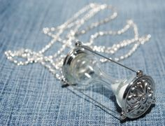 """Life's like an hourglass glued to the table. The sands of time continue to fall, and you can't turn the hourglass over.""  To view all available jewelry, click here: https://www.etsy.com/shop/CrystalCharriere?section_id=14535807"