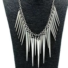 Fashion spike necklace New in packaging. The color is silver. Lightweight. Spikes are in 2 different sizes. The metal is alloy. No trades. Firm price! Jewelry Necklaces