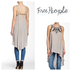 "Free People Embellished Tank Intricate embroidery and sparkling beads put a romantic twist on a long and loose tank finished with a cascading hi-lo hem. - Jewel neck - Sleeveless - Unlined - Approx. 30"" shortest length, 41"" longest length, shoulder to hem.  100% viscose Color:  Light Grey Dry clean or hand wash cold, dry flat. ///////NWOT/////// Free People Tops"