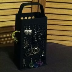 Old cheese grater+spray paint=a snazzy new way to organize my earrings!! I actually made something I found on Pinterest! :)