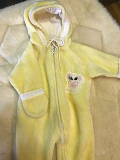 """Vintage yellow Bunnywarmer one piece, hooded sleeper. Size not marked. Please refer to measurements before purchasing. Measures 23"""" chest 24"""" shoulder to heel 15"""" shoulder to saddle Please contact me with any questions before purchasing this item. Please view all pictures provided as they lend to the description. All sales are final. No returns accepted. Please take a minute to be sure that whatever you are purchasing is a perfect fit for you. You can do this by checking with s..."""