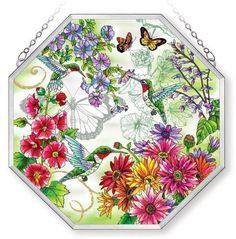 """Amia Window Decor Panel Ripple Glass with Polished Aluminum Frame, Butterfly Design, 15 by 15-Inch, Octagon by Amia. $69.00. Comes in a sturdy package. Includes chain for hanging. Beautifully detailed, handpainted on ripple glass.. The pleasure of watching musical genius can be imagined in the creativity artist Sandy Clough's design accomplishes in this """"Hummingbird Garden"""" design.  Amia's artistic """"genius"""" in hand-painted glass brings home hummingbirds that w..."""