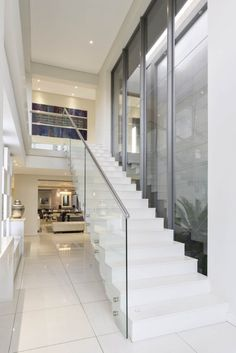 This contemporary home is one of four on a family-owned private estate on the outskirts of Johannesburg. Interior Stairs, Big Houses, Architecture Design, House Plans, Contemporary, Home Decor, Design For Home, Large Homes, Architecture Layout