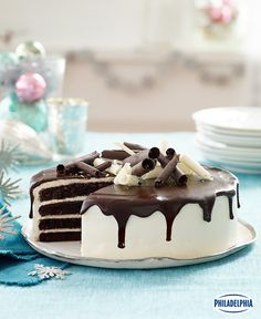Chocolate cake gets all dressed up! When the occasion calls for an extraordinary dessert, this dramatic-looking chocolate Tuxedo Cake with cream cheese frosting and chocolate glaze is the one to make. Chocolate Glaze, Mint Chocolate, Chocolate Desserts, Cake With Cream Cheese, Cream Cheese Frosting, Tuxedo Cake, Cake Recipes, Dessert Recipes, Round Cakes