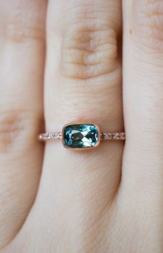 a Cushion Cut ethically sourced Sapphire engagement ring by S. Kind & Co.