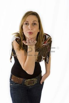 Beautiful young woman blowing kisses against white background