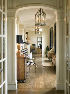 If my mom had a hallway like this, I'd be over all the time. I love everything about the hallway from the light fixture to the floor. The built in columns, the black and white stripped upholstery, the furniture and pops of gold...yum! Seriously sophisticated scenery (alliteration points!)