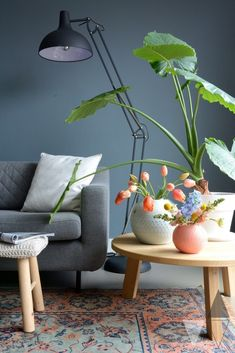 greys with pops of colour. Love the little round table too